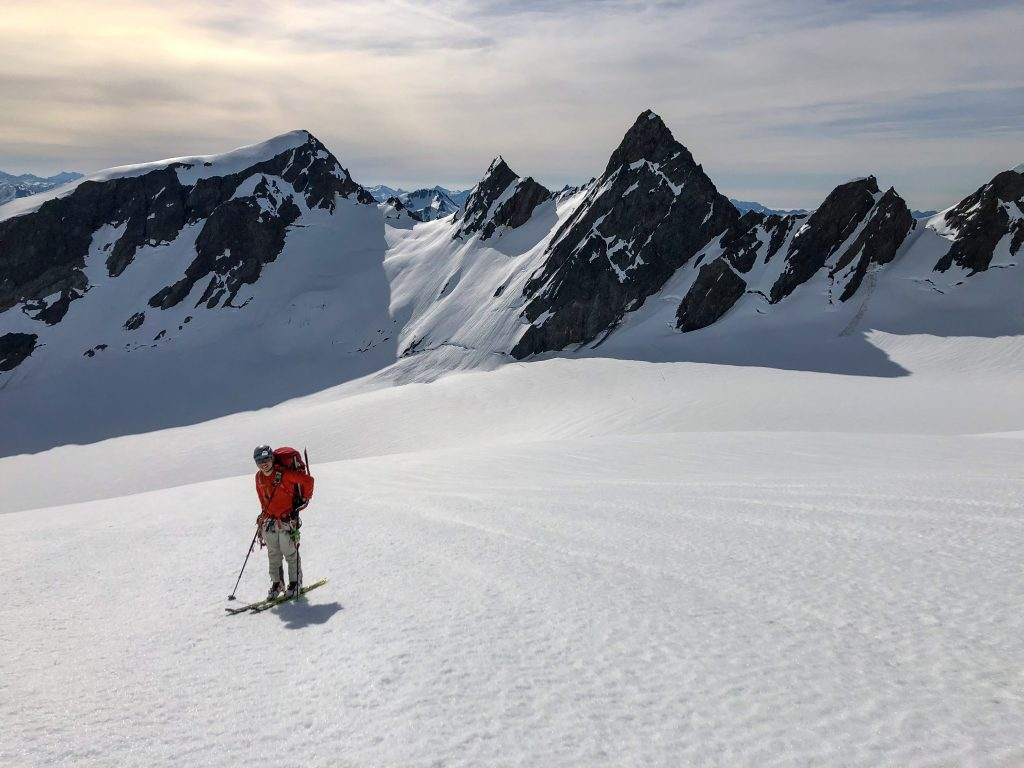 Peter on the Hoh glacier, with the Athena peaks behind him.