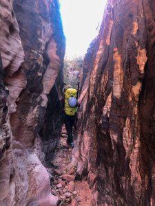 Melissa walking through a slot canyon en route to panty wall.