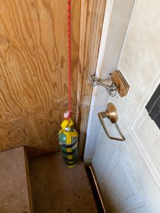 Novel use of an O2 bottle - a weight to help keep the door closed on the privy at Camp Schurman.