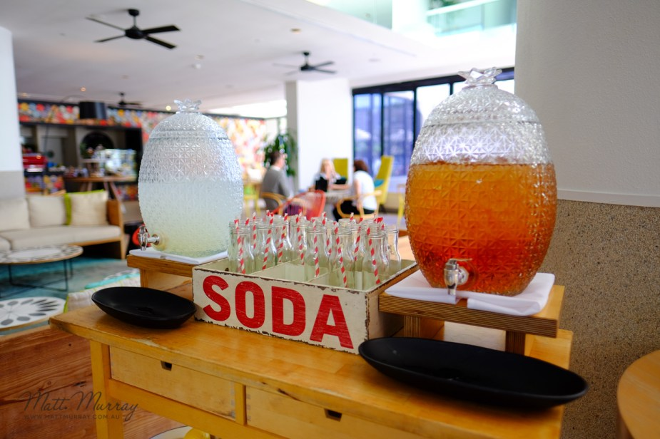 Free soda in cute bottles with striped straws at the QT Hotel Gold Coast