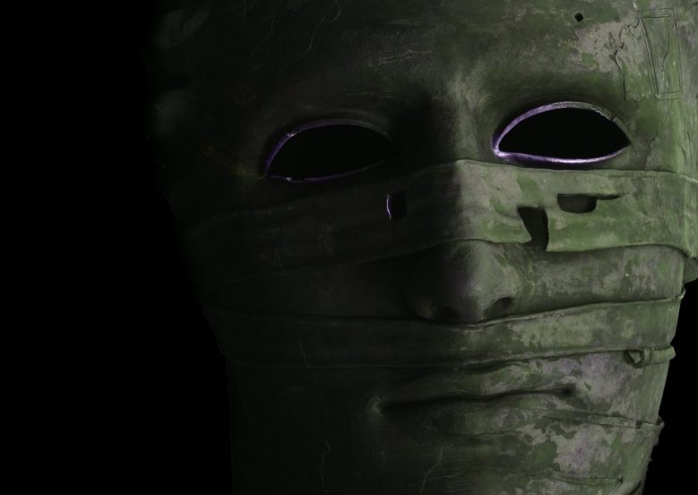 Man in green mask