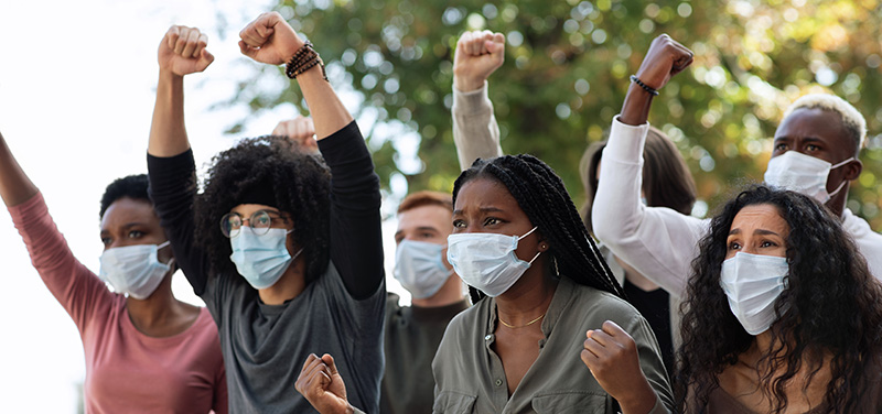 People with face coverings protesting. buy legal CBD oil in Hawaii online.