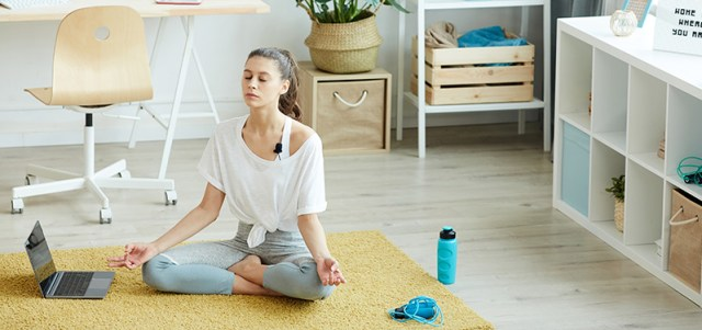 Woman indoors in a yoga pose. Buy CBD gummies for anxiety and depression online in Hawaii.
