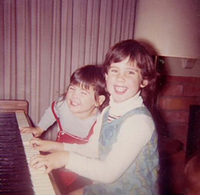 Young Maura at the piano