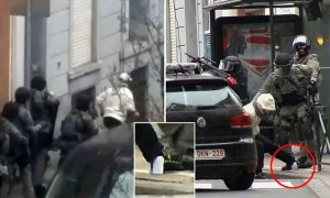 In this framegrab taken from VTM, something appears to drop from inside the trouser leg of Salah Abdeslam as he is arrested by police and bundled into a police vehicle during a raid in the Molenbeek neighborhood of Brussels, Belgium, Friday March 18, 2016. After an intense four-month manhunt across Europe and beyond, police on Friday captured Salah Abdeslam, the top suspect in last year's deadly Paris attacks, in the same Brussels neighborhood where he grew up. (VTM via AP) BELGIUM OUT
