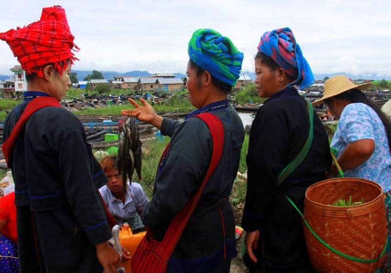 Shan women buying fish at lake inle weekly markets