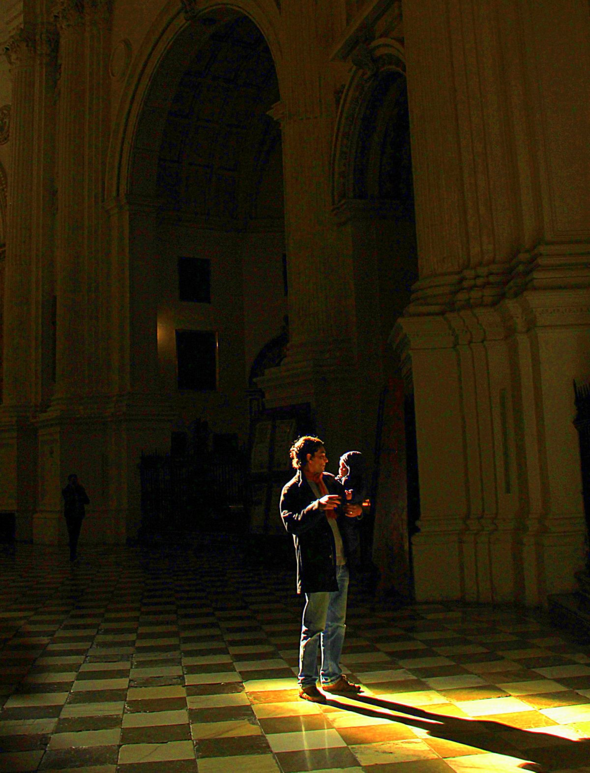 Light filters through the Granada Cathedral