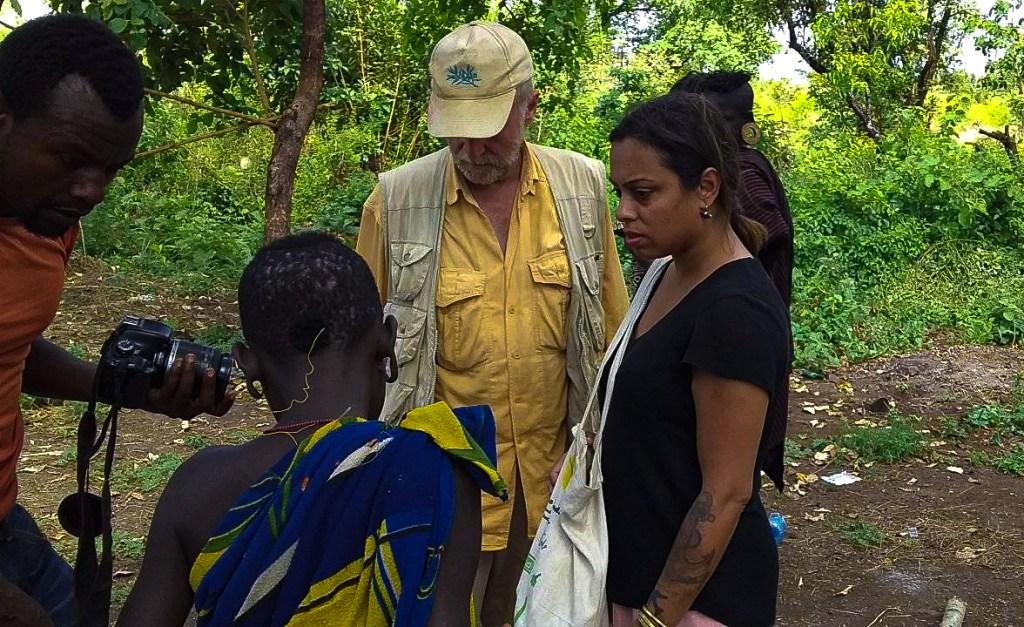 Visitors at a Mursi village in Omo Valley travel