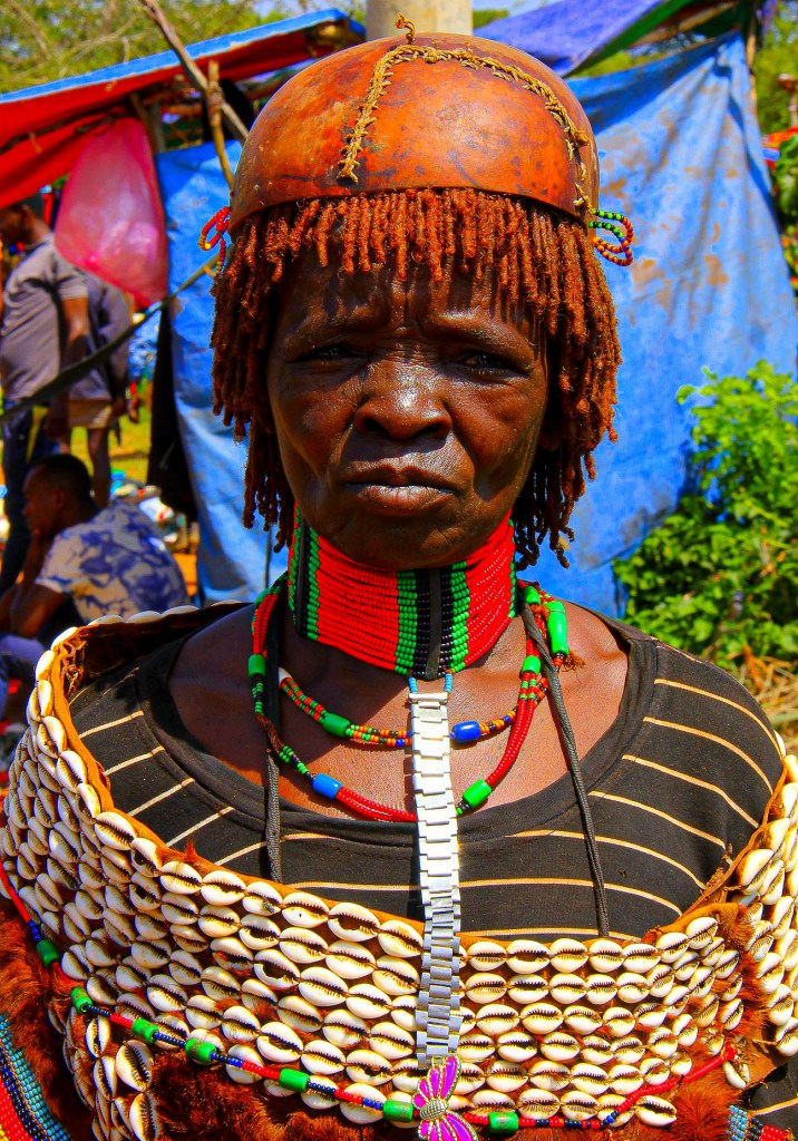 A Hamar woman dressed up for a market day in Omo Valley in Ethiopia