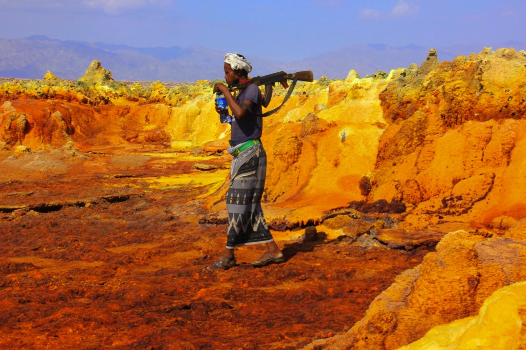 An Afar man acts as an armed guard for traveler groups visiting Danakil Depression