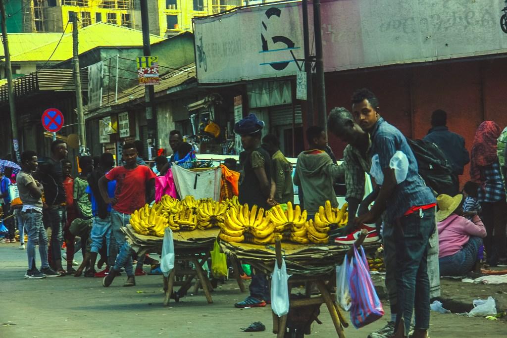 A man selling local bananas in Addis Mercato