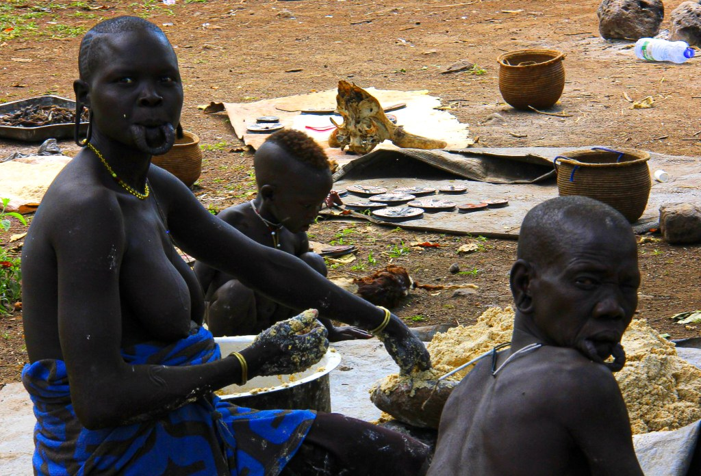 Mursi women with their cut out lower lips in lower omo valley