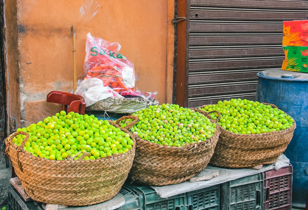 Fresh olives for sale at a market near Muizz Street