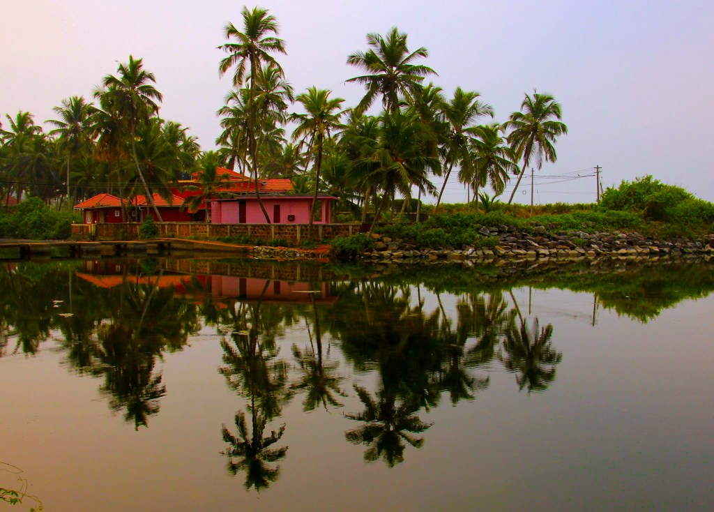 The beautiful Kannur homestay reflected on the lagoon