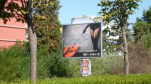 Bulgarian billboard for restaurant featuring dominatrix and lobster