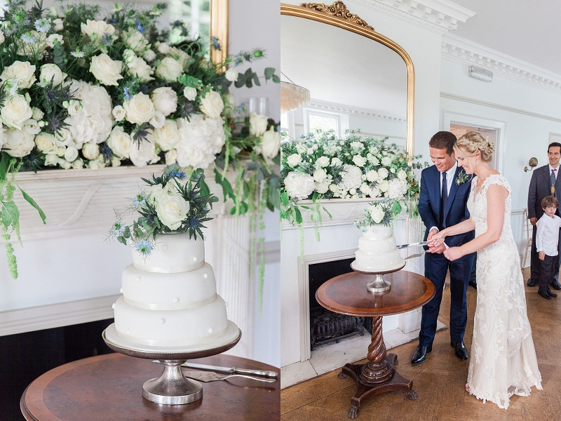 Couple Cutting Their Blue and White Topped Wedding Cake At Belair House