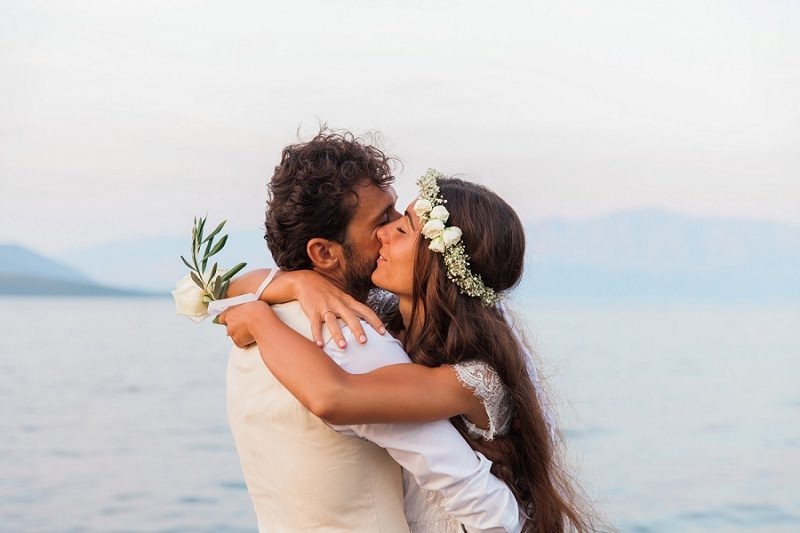 Bride and Groom Hugging Against the Backdrop of the Ionian Sea