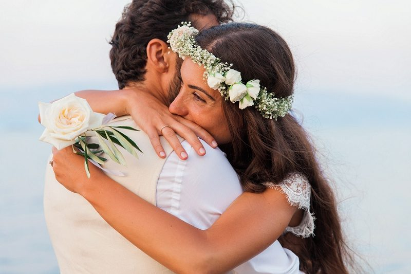 Close Up of the Bride Embracing the Groom