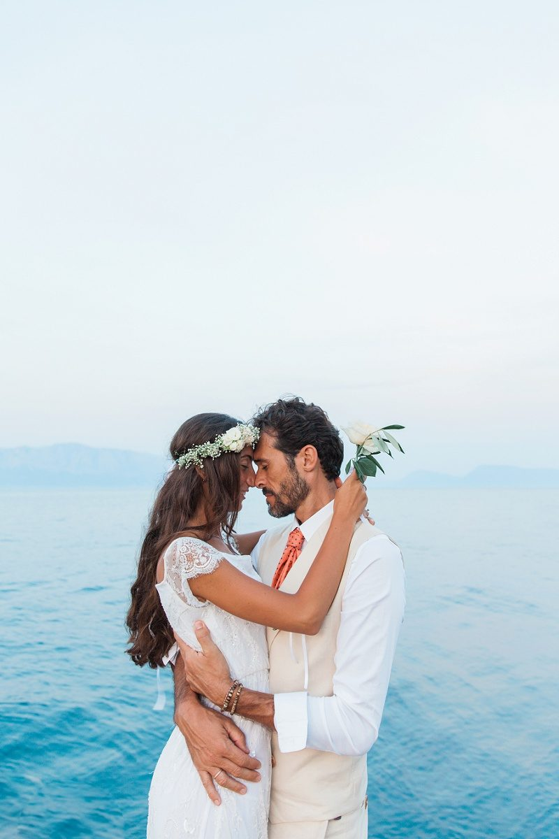 Couple in Romantic Embrace on the Jetty at Ionian Blue Hotel on Lefkada
