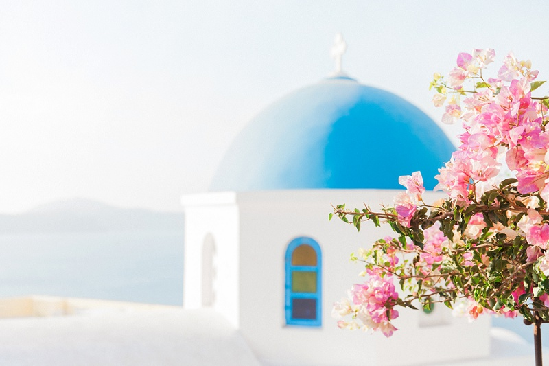 Blue and White Church and Pink Bougainvillea in Oia Santorini