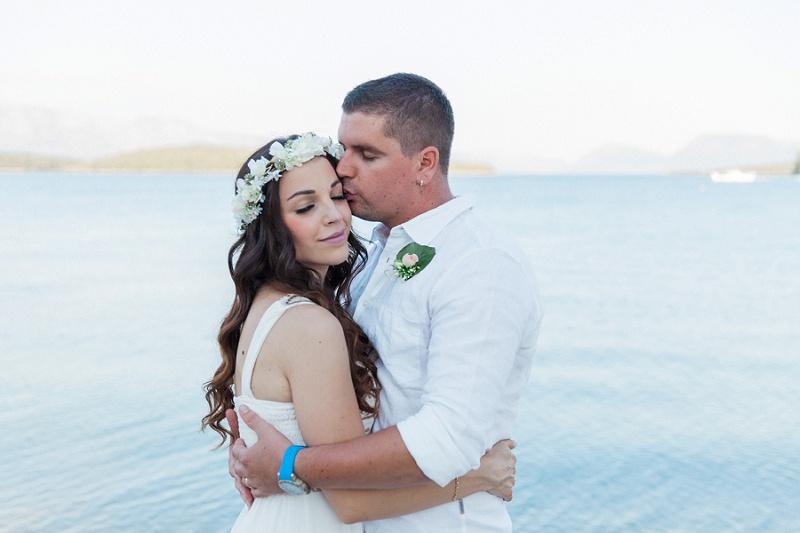 Bride and Groom Hugging After Their Seaside Elopement