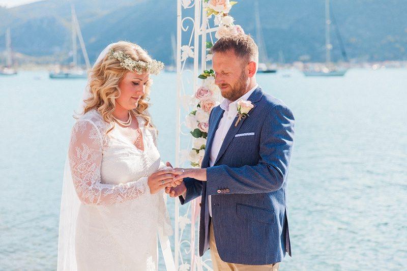 Bride and Groom Exchanging Rings At Their Vintage Wedding