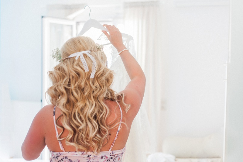 Bride Getting Ready To Put On Her Lace Wedding Dress