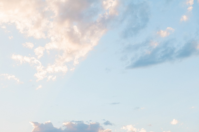 White and Grey Clouds in Pale Blue Sky