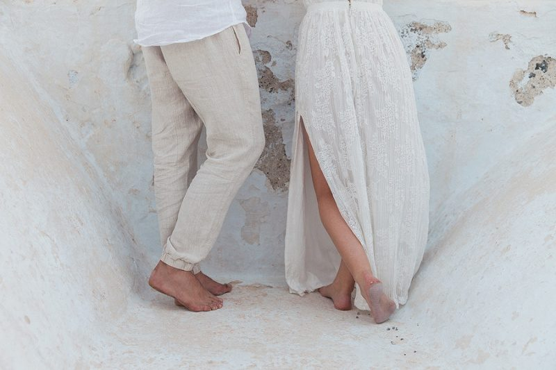 Barefoot Newlyweds on a Church Roof After Their Sunset Elopement In Santorini