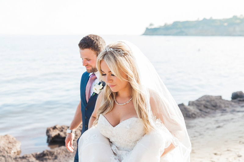 Bride and Groom walking down the beach together on Kefalonia
