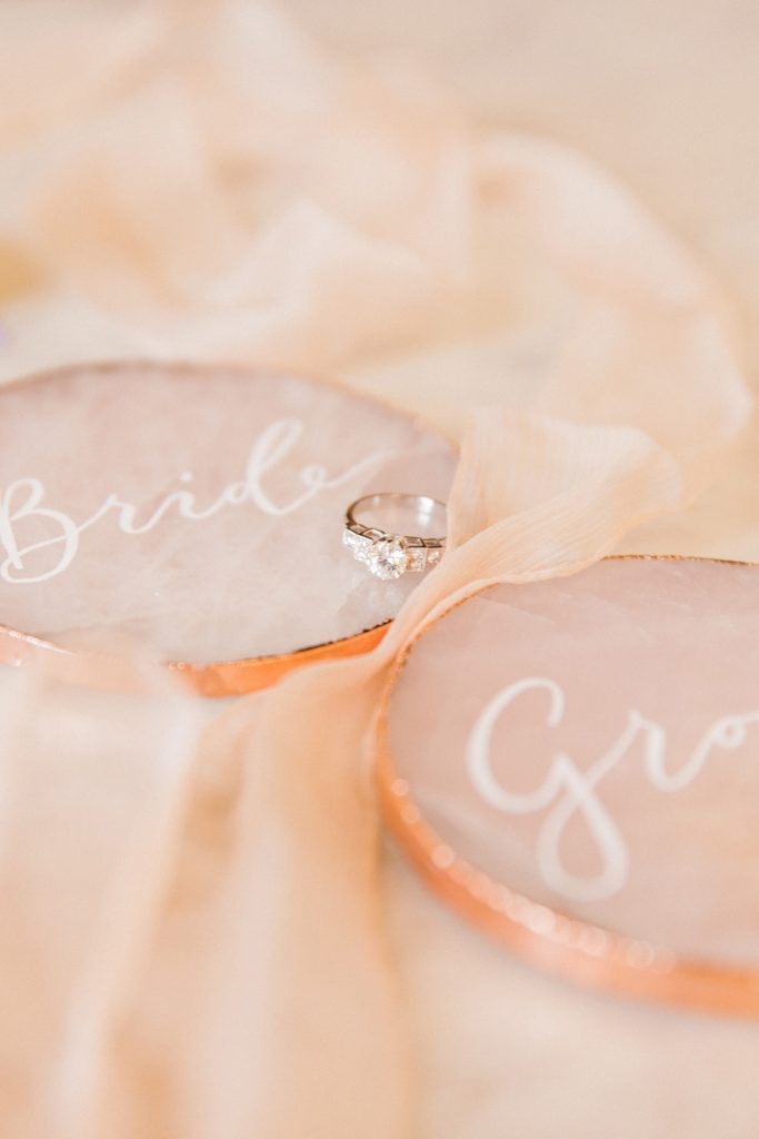 Diamond engagement ring by London Victoria Ring Company and calligraphy rose quartz slices by Scritto