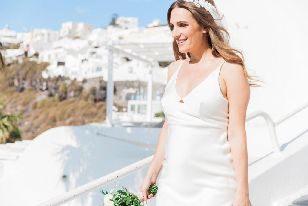 Bride making her way to the ceremony at her Santorini elopement