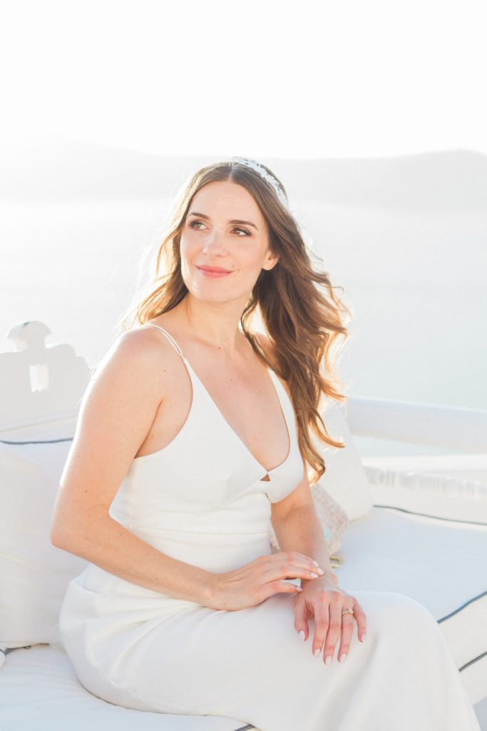 Portrait of a beautiful bride against a veiw of the caldera