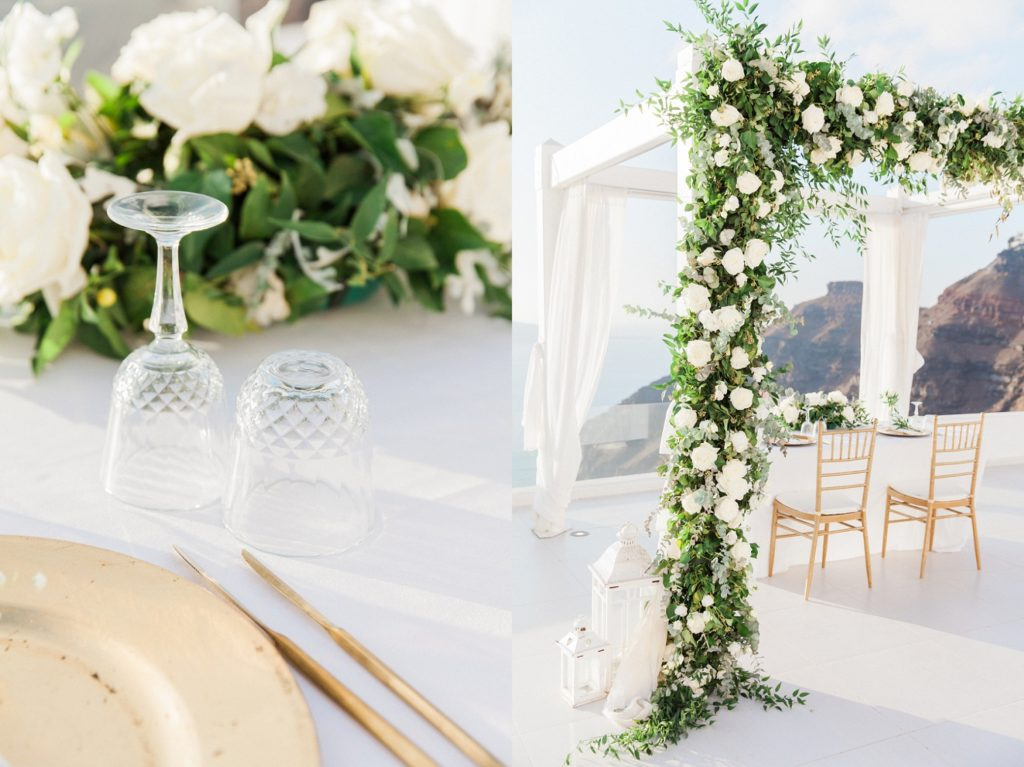 Table for two under a wedding arch on the balcony at Dana Villas in Santorini