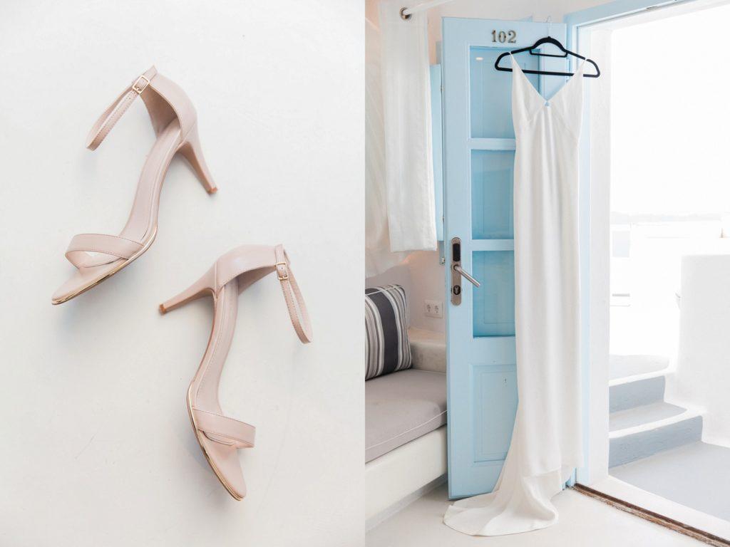 Carvela heels and the brides wedding dress hanging in the doorway of the honeymoon suite at Dana Villas Santorini