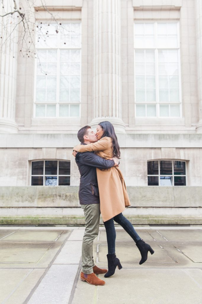 Couple kissing outside the British Museum in London
