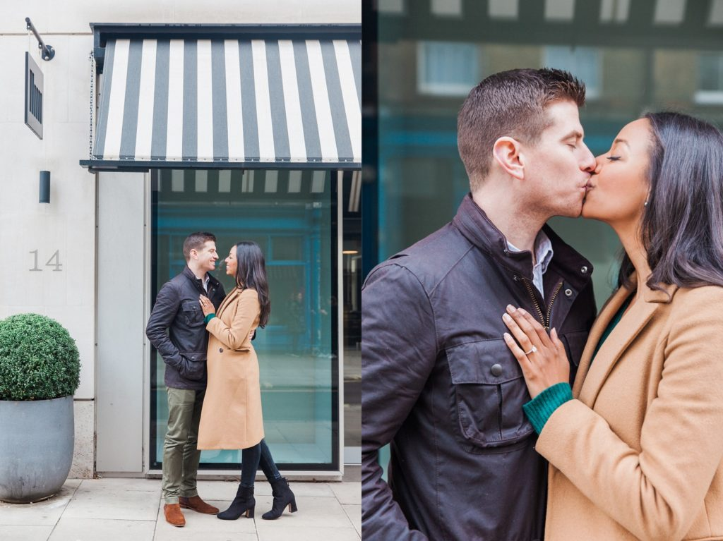 Couple kissing in the doorway of a cafe in Fitzrovia in London