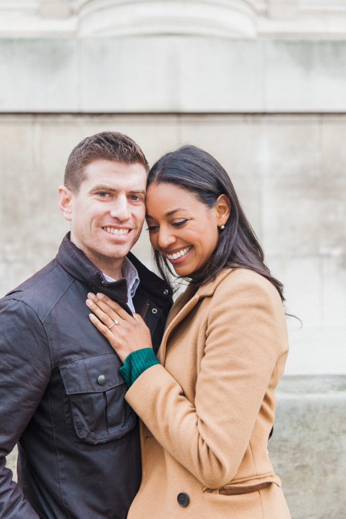 Portrait of a smiling couple during their Charlotte Street Hotel engagement session