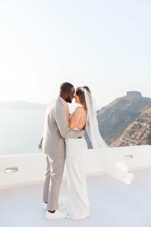 Bride and groom dancing at their Santorini wedding