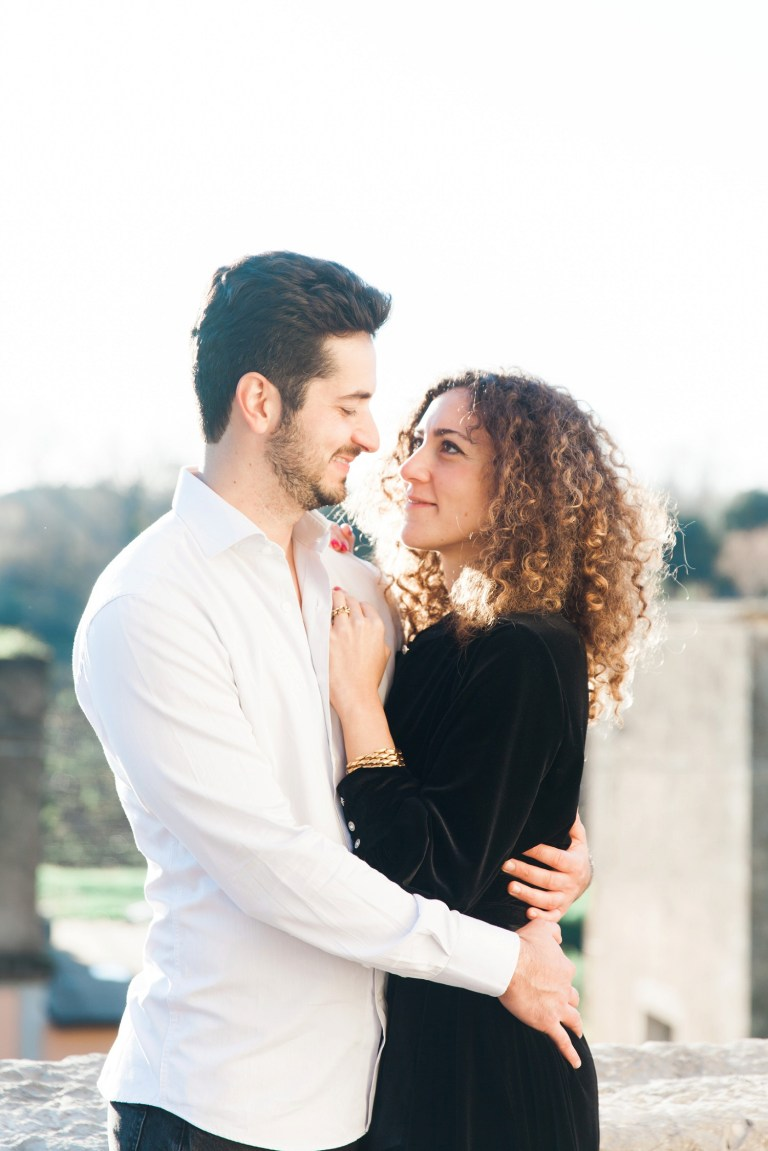 Couple smile at each other during their Italian countryside couple photography session