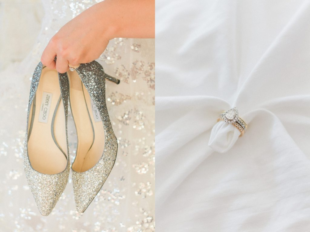 Sparkling blue and silver Jimmy Choo heels next to a Cartier diamond ring