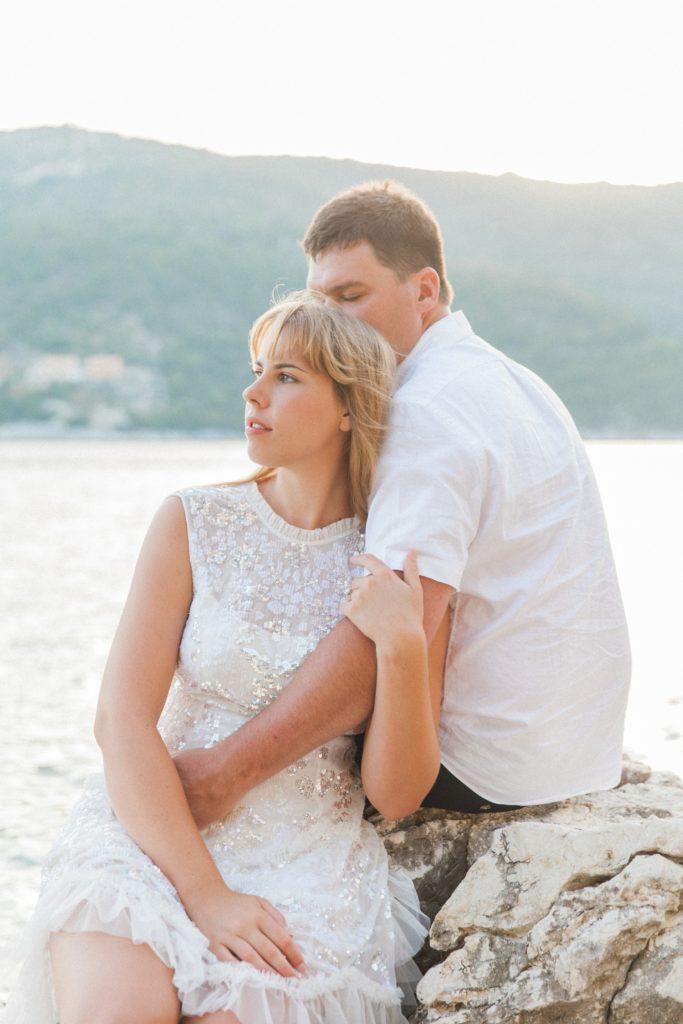 Couple on the rocks at San Nicolas Resort Hotel in Lefkada