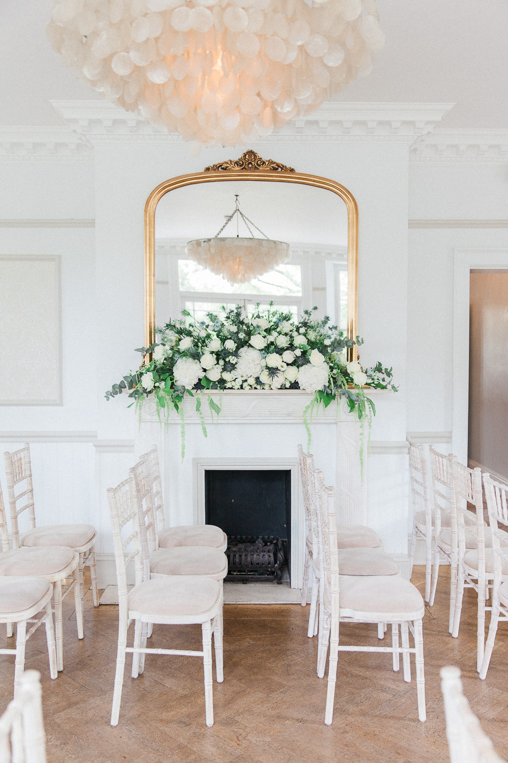 Decorated fireplace in the indoor ceremony room of Belair House wedding venue in London