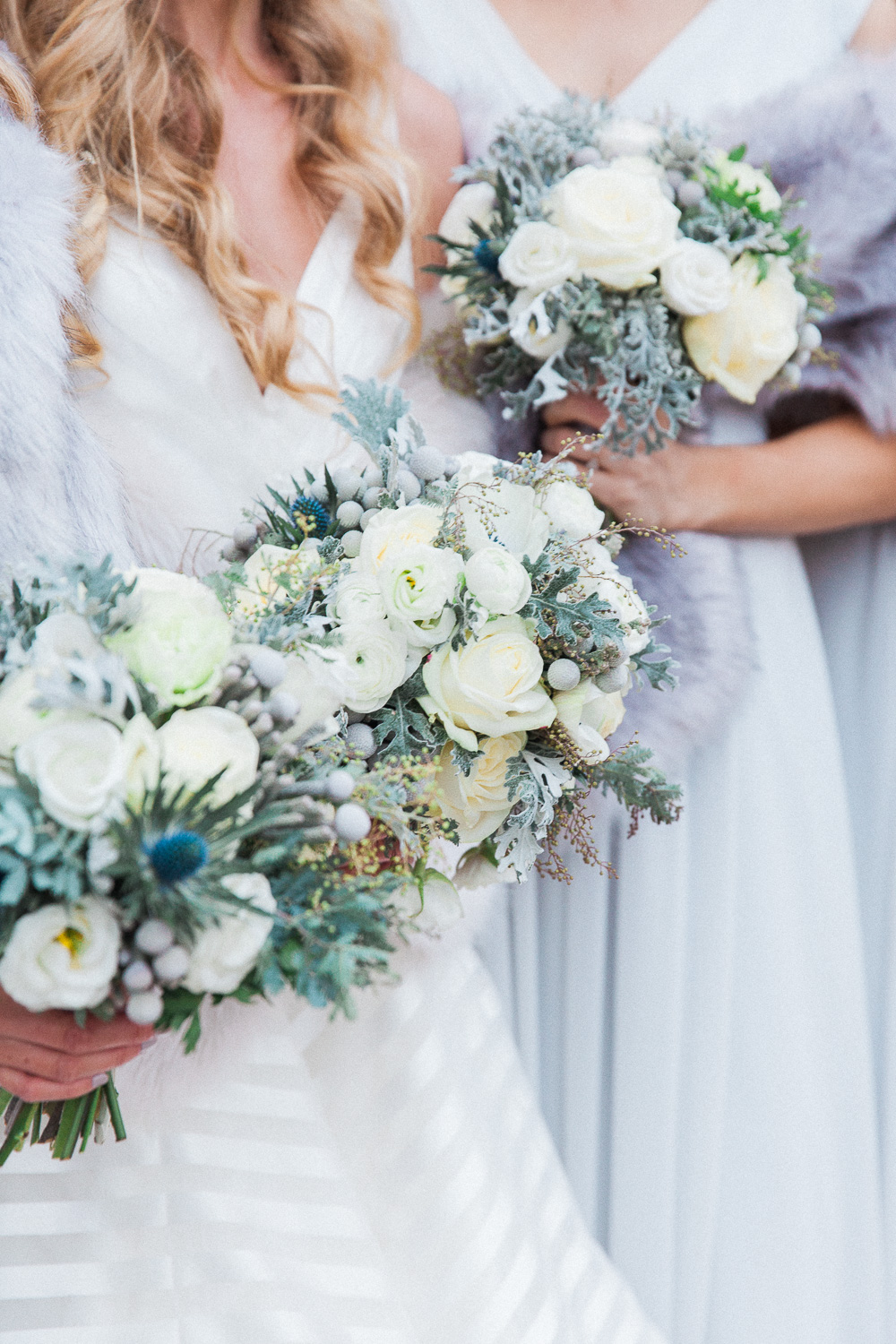 Bride and bridesmaids winter wedding bouquets in white and blue by London wedding photographer Maxeen Kim