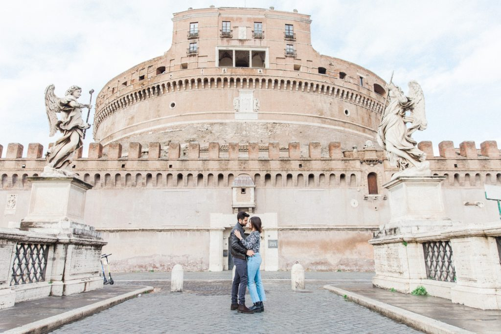 Couple embrace in front of Castel Sant'Angelo during their Rome couple photography session