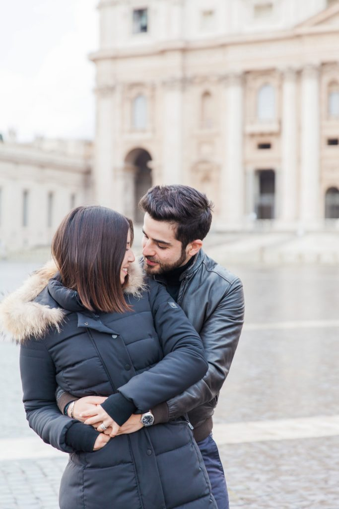 Couple share a moment in front of St. Peter's Basilica during their Rome photography session