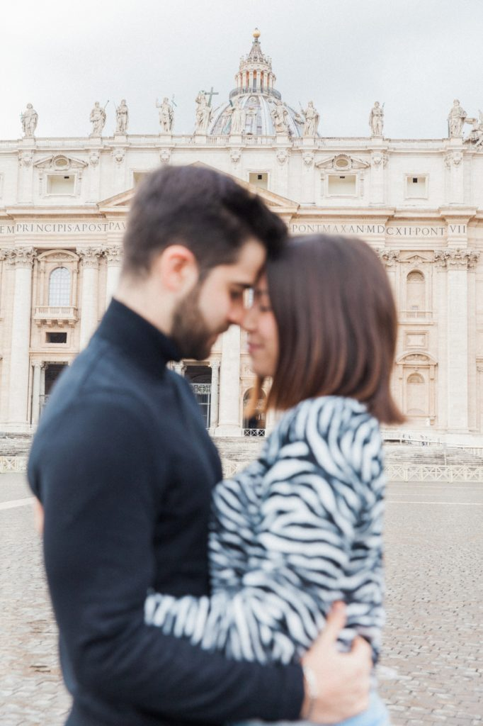 St. Peter's Basilica with a Roman couple blurred in the foreground