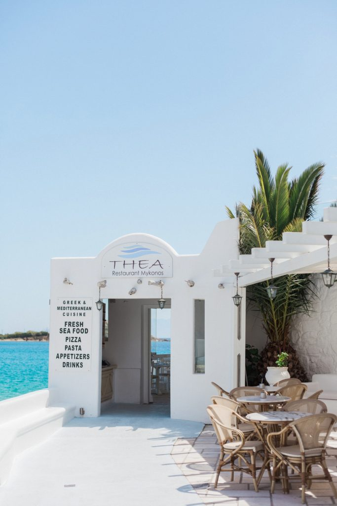 The whitewashed entrance of Thea Restaurant Mykonos