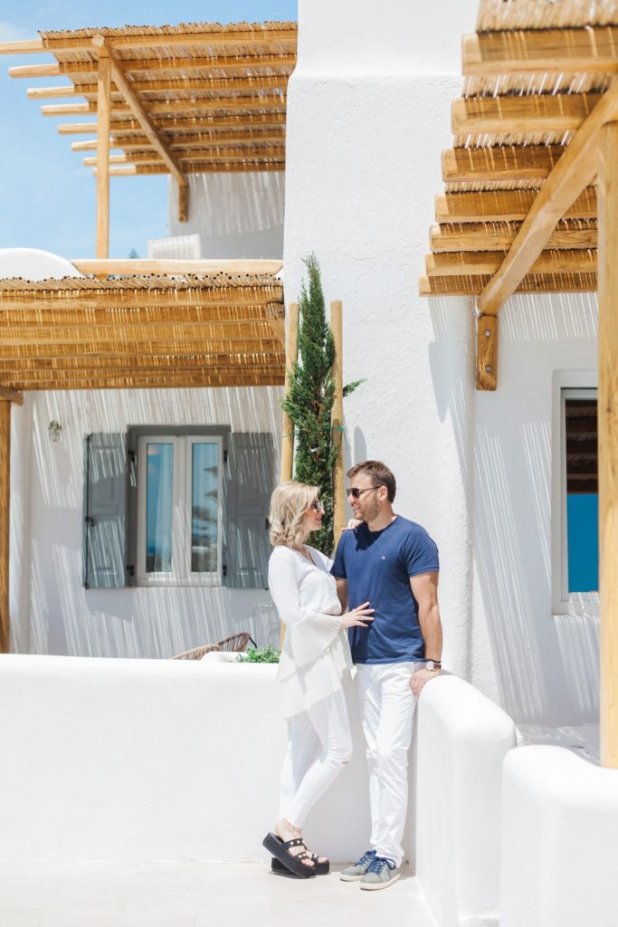 Couple embrace in front of one of the suites at Artemoulas Studios Mykonos