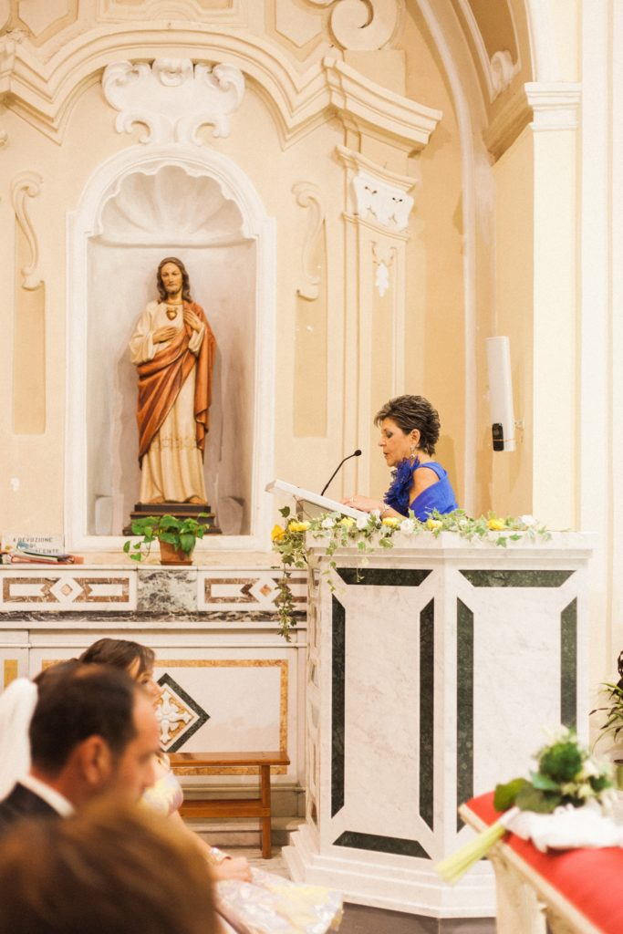 Mother-of-the-bride does a reading in a traditional church in Apulia
